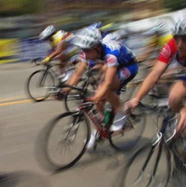 men in a bicycle race with motion blur