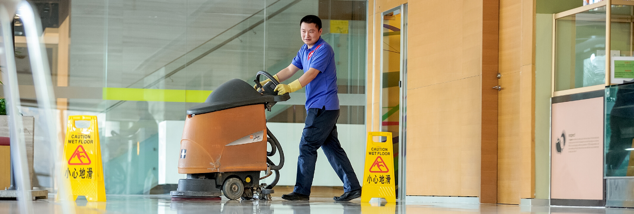 Sodexo facilities management employee helping a customer at their desk