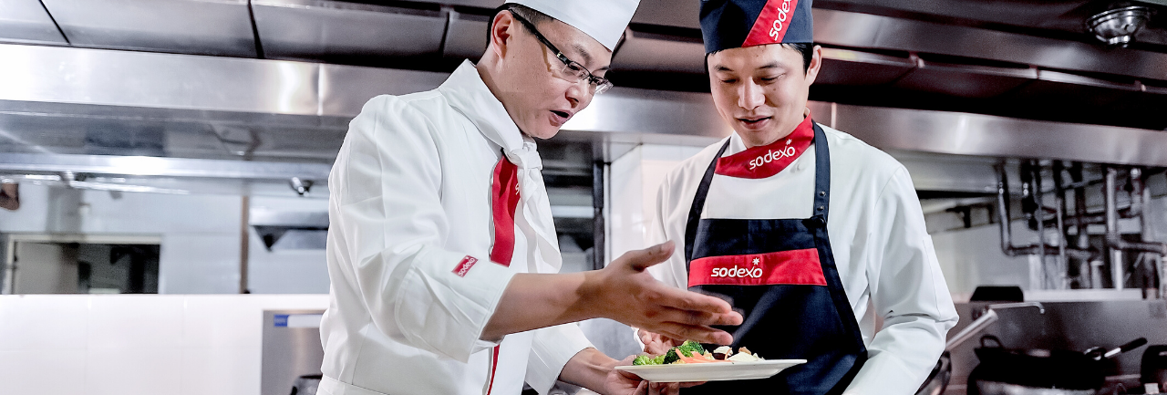 Sodexo employee serving food